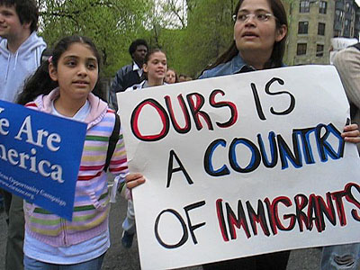 Protester holds sign: Ours is a country of immigrants