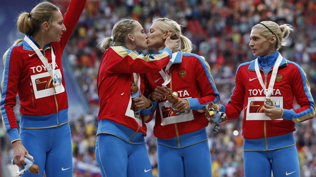 Gold medallists team Russia celebrate at the women's 4x400 metres relay victory ceremony during the IAAF World Athletics Championships at the Luzhniki stadium in Moscow