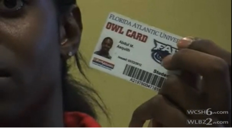 Abdul Asquith holds up his ID