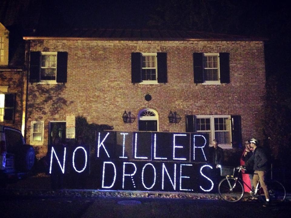 No Killer Drones light display outside Jeh Johnson's house
