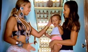 Beyoncé caressing the head of another baby.