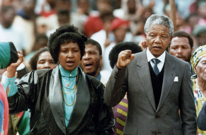 Nelson Mandela with his wife Winnie, at a rally after his release from prison