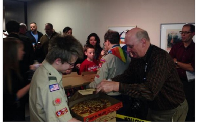Boy scouts bringing pizza to county workers