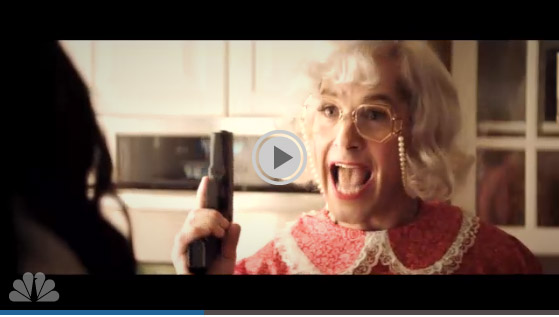 Paul Rudd dressed as a grandmother wielding a gun in SNL's White Christmas sketch