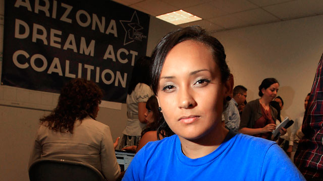Erika Andiola looks into camera wearing blue shirt