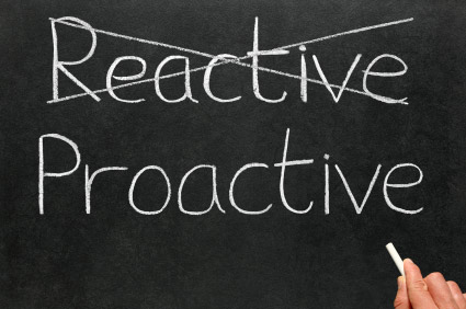 black board with reactive crossed out and proactive under it