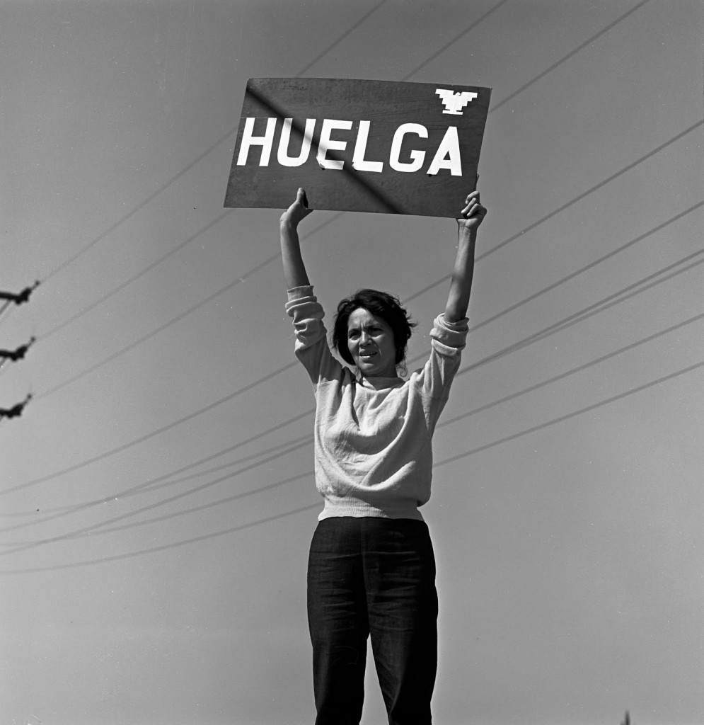 "Dolores Huerta holding a sign that says ""HUELGA"" (Strike)"