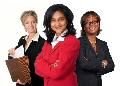Three women wearing business professional clothing.