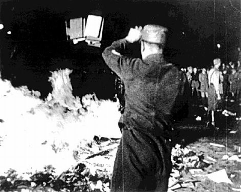 This photo is famous; less well known is its context. Nazi footsoldiers are burning the library of Magnus Hirschfeld's Institute for Sexual Research-- one of the first places of its kind to employ trans women and advocate for what we would now call LGBT rights. Hirschfeld was also a feminist.