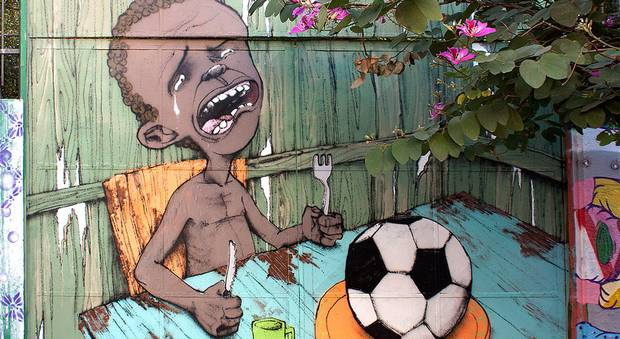 street art of crying kid with a soccer ball on his plate