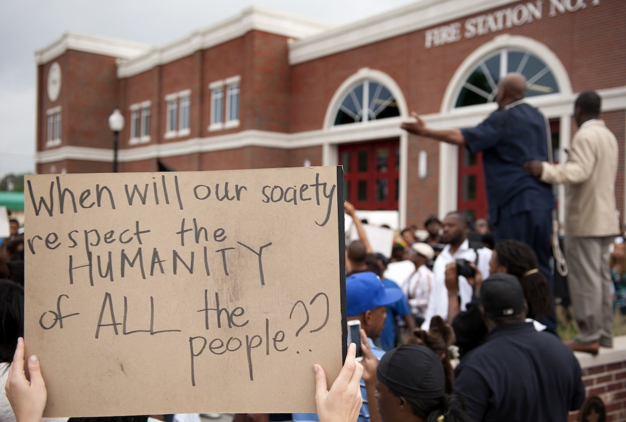 ferguson-rally-humanity-sign