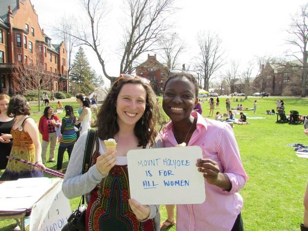 Two students hold a sign: Mt Holyoke is for all women